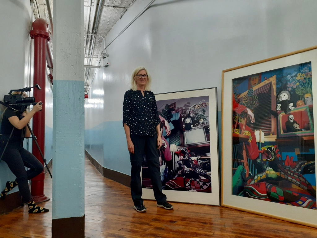 "Barbara with ""Amok"" photo and painting"